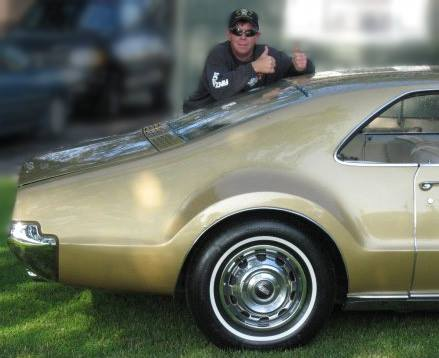 Dan Jarvi with his beloved Olds Toronado.