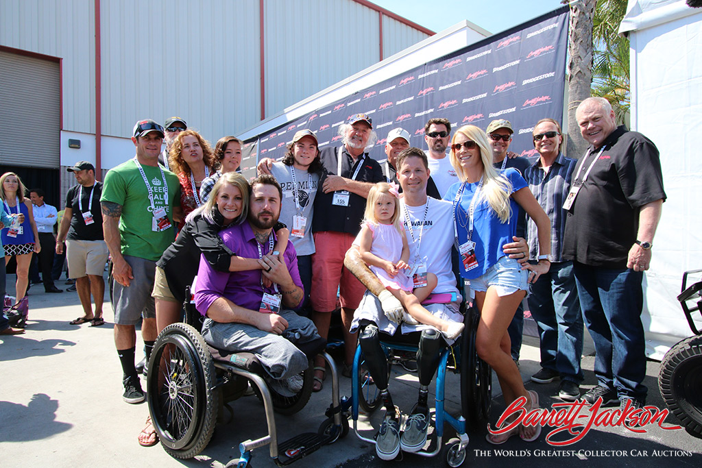 Craig Jackson and Steve Davis (far right) joined Marcus Luttrell (back row, third from right) and some other representatives of Luttrell's Lone Survivor Foundation after the sale of the Hennessey Viper Venom 500.