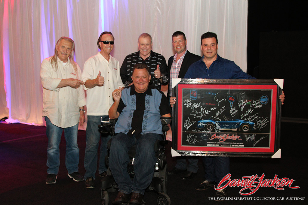 Barrett-Jackson's Gary Bennett, Steve Davis, Craig Jackson and auctioneer Joseph Mast with Darrell Gwynn. A special poster autographed by celebrities and famous race car drivers was auctioned off for the Darrell Gwynn Foundation – bringing $17,000 to the worthy cause.