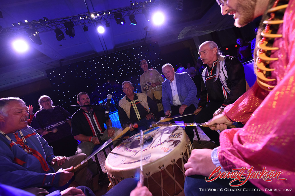 Consignor Joe Petralia and Barrett-Jackson Chairman and CEO Craig Jackson join Mohegan tribal drummers during the Opening Night Gala.
