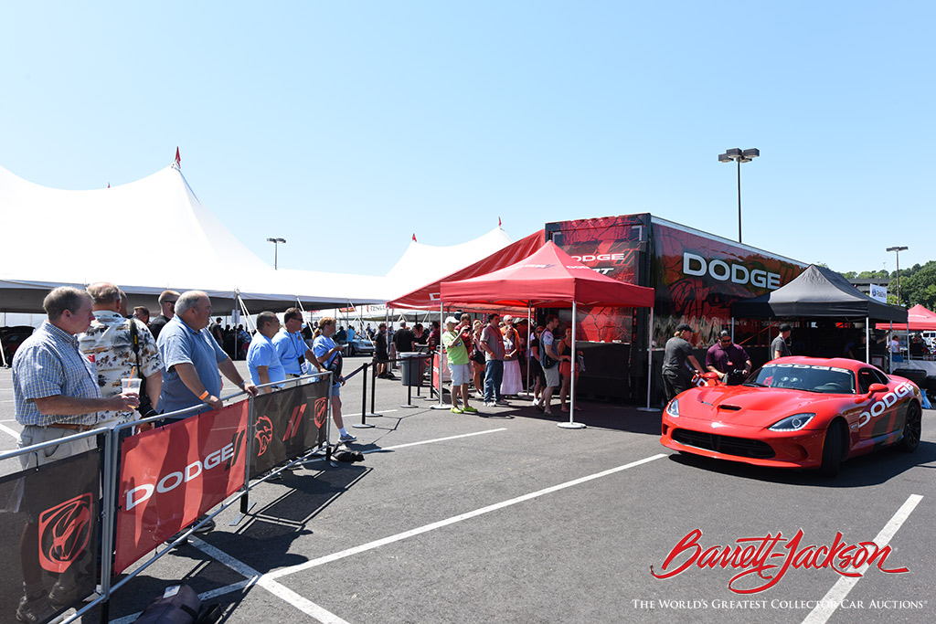 Enthusiasts get ready to go on a thrilling ride in a Dodge Viper.