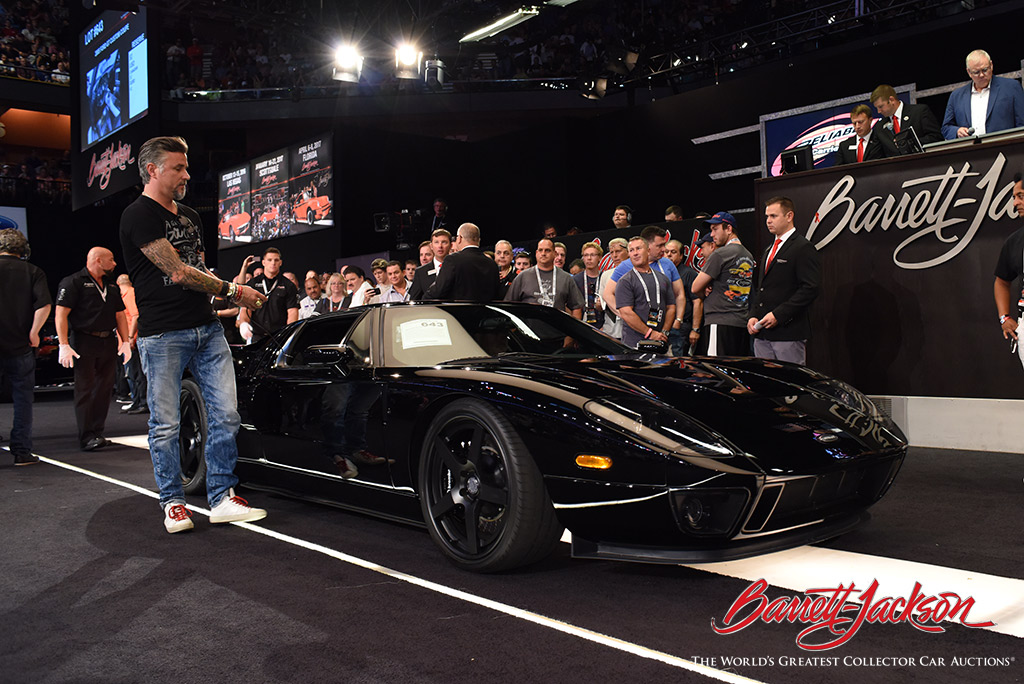 "Gas Monkey Garage's Richard Rawlings with his ""GMGT"" - a 2005 Ford GT Custom Coupe (Lot #643), which sold for $253,000."