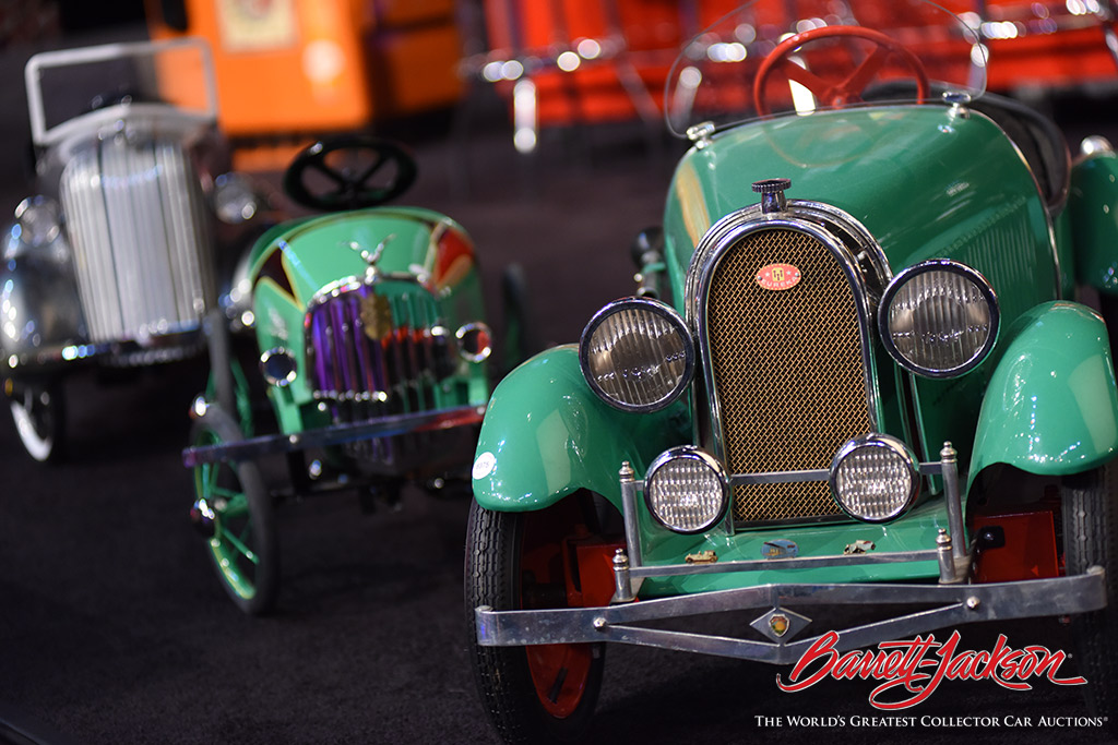 Exquisitely restored pedal cars at Saturday's Automobilia Auction.