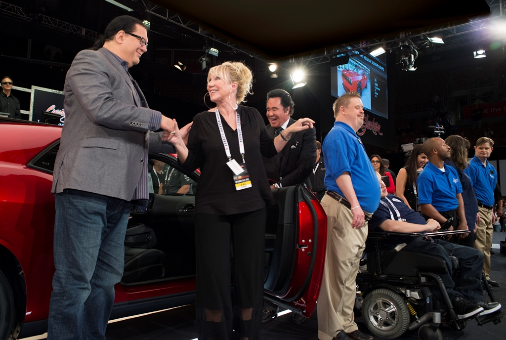 "Entertainer Penn Jillette with Opportunity Village Chief Development Officer Linda Smith and ""Mr. Las Vegas"" Wayne Newton on the block with the 2015 Dodge Challenger SRT Hellcat VIN #001, which sold at the 2014 Las Vegas Auction for $1.65 million - 100% of which went to Opportunity Village."