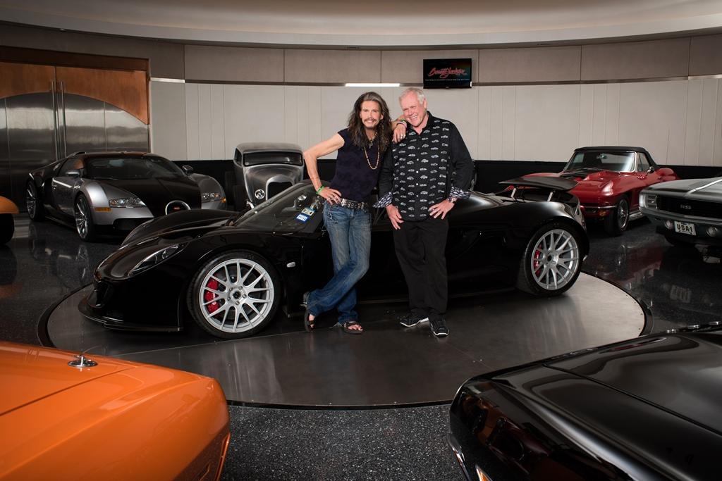 Rock and roll legend Steven Tyler and Barrett-Jackson chairman & CEO Craig Jackson in front of Tyler's Hennessey Venom GT Spyder.