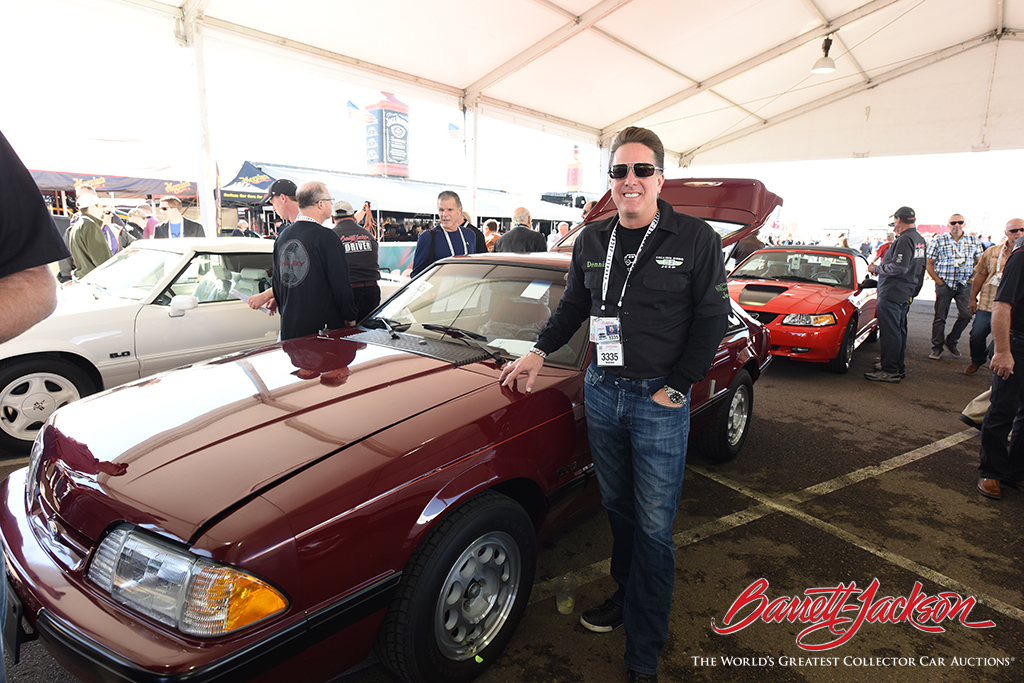 Gas Monkey Garage's Dennis Collins with one of the eight Mustangs he brought to the block - six of which set new world records at auction.