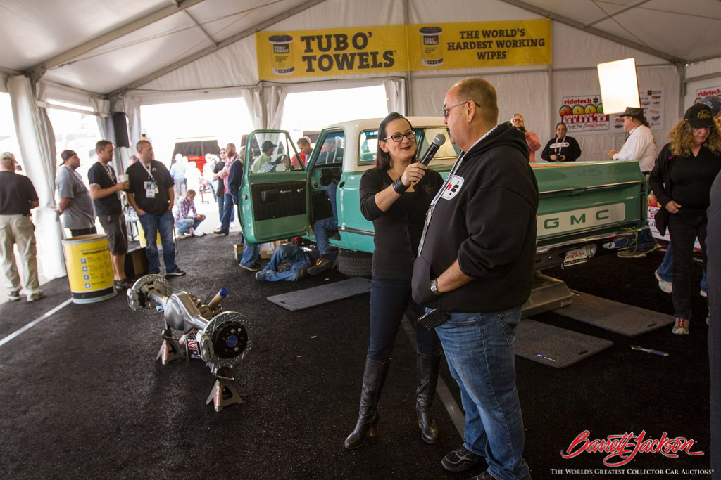 "Bogi from ""All Girls Garage"" interviews a RideTech team member in the new DIY Pavilion about their 48-hour build of a 1968 GMC C-10 Pickup that crossed the block as Lot #7005 on the final day of the auction."