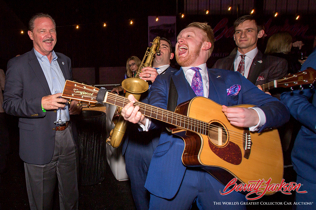 Scottsdale Mayor Jim Lane (left) enjoying the antics of The London Essentials during the Opening Night Gala.