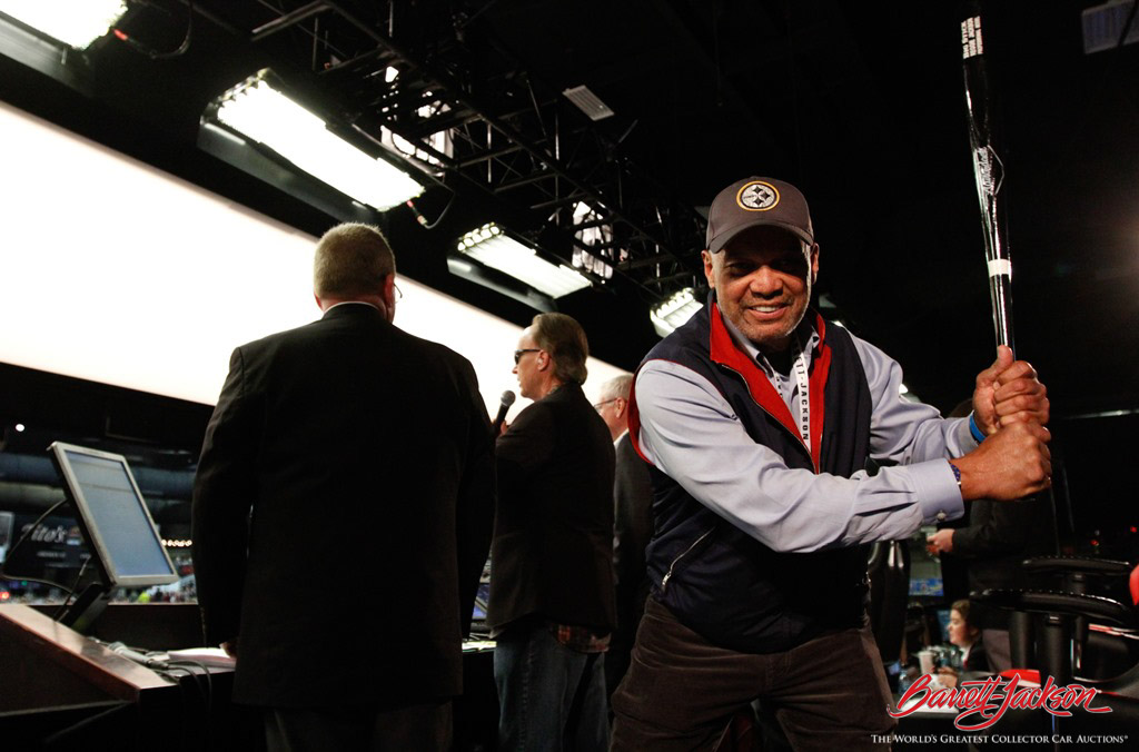 Baseball great Reggie Jackson hams it up behind the scenes on the auction block.