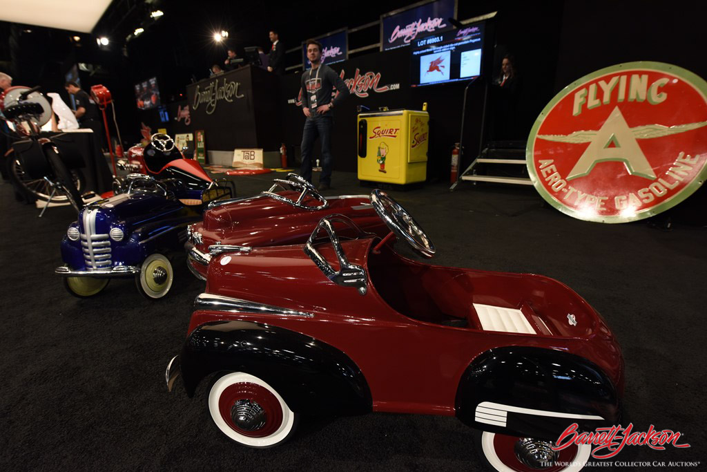 Pristine pedal cars take their turn onstage during the Automobilia Auction.
