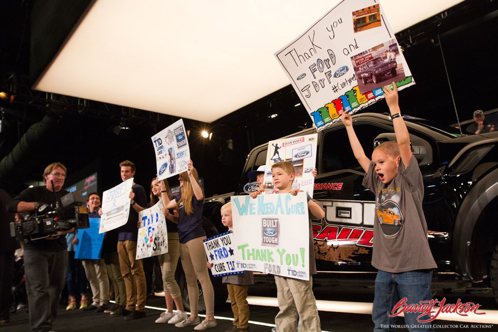 Enthusiastic kids from JDRF helped raise $157,000 (plus another $50,000 donation) for the organization through the sale of a 2017 Ford Raptor Pickup (Lot #3004).