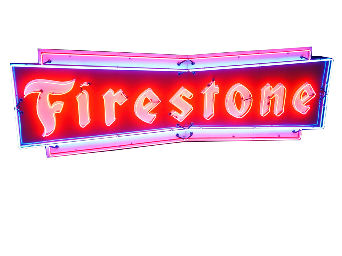Imagine this giant Firestone Tires neon sign from the 1950s (Lot #5898) lighting up your garage! A new transformer ensures brilliant light on this immensely clean sign.