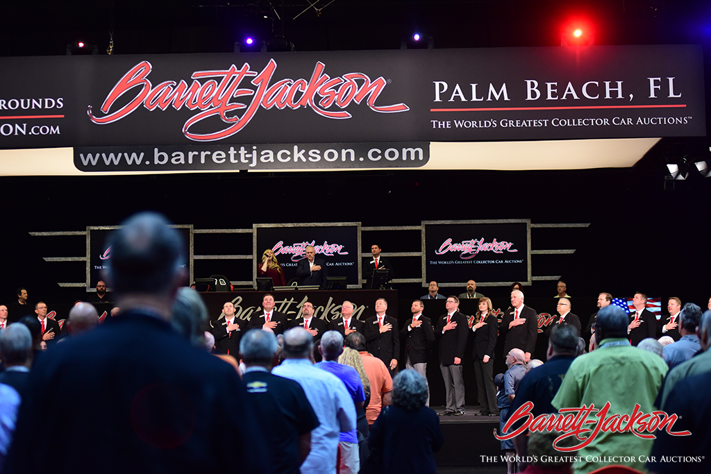 Fort Worth, Florida, resident Kendall Jackson performs the National Anthem to open today's collector car auction.