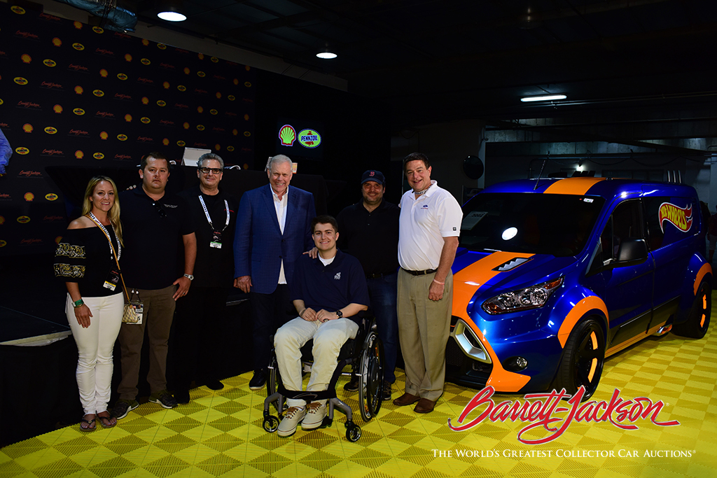 The winning bidders (left) on a unique 2014 Ford Hot Wheels Transit Connect (Lot #3002) with Craig Jackson, wheelchair recipient Jack Gerard, Scott Roy from the Darrell Gwynn Chapter team and Ford Performance Marketing Manager Jim Owens. The sale brought in $50,000 for the Darrell Gwynn Quality of Life Chapter of The Buoniconti Fund to Cure Paralysis.