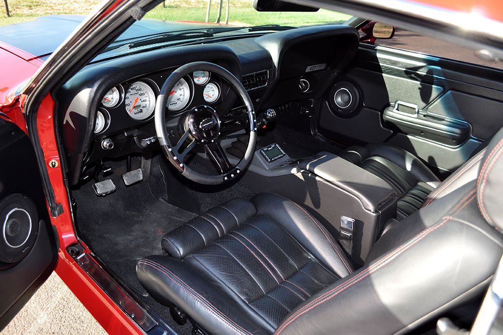 The '70 Mustang Resto-Mod crossing the block in Las Vegas has modern conveniences like mirrors with lighted turn signals, power seats and cold air conditioning.