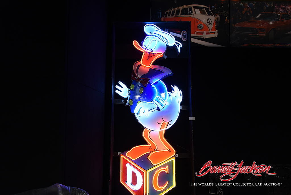 Lot #9492 - Very iconic 1950s Donald Duck neon porcelain parking lot entrance sign from Disneyland - $48,300