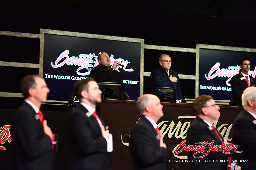 Patrick Lauder, official anthem singer of the Arizona Coyotes, opened the collector car auction by singing the National Anthem.