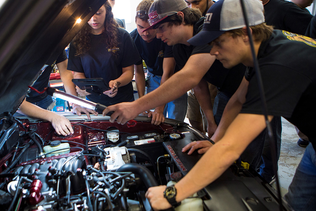 Jordon Vocational High School students hard at work on their Quaker State Best-in-Class-winning Ford Mustang in 2016.