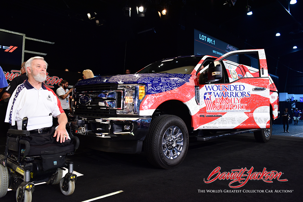 Retired Captain Tommy Clack (left), with his new mobility-equipped Ford F-250 pickup, courtesy of Wounded Warrior Family Support and the Military Order of the Purple Heart.