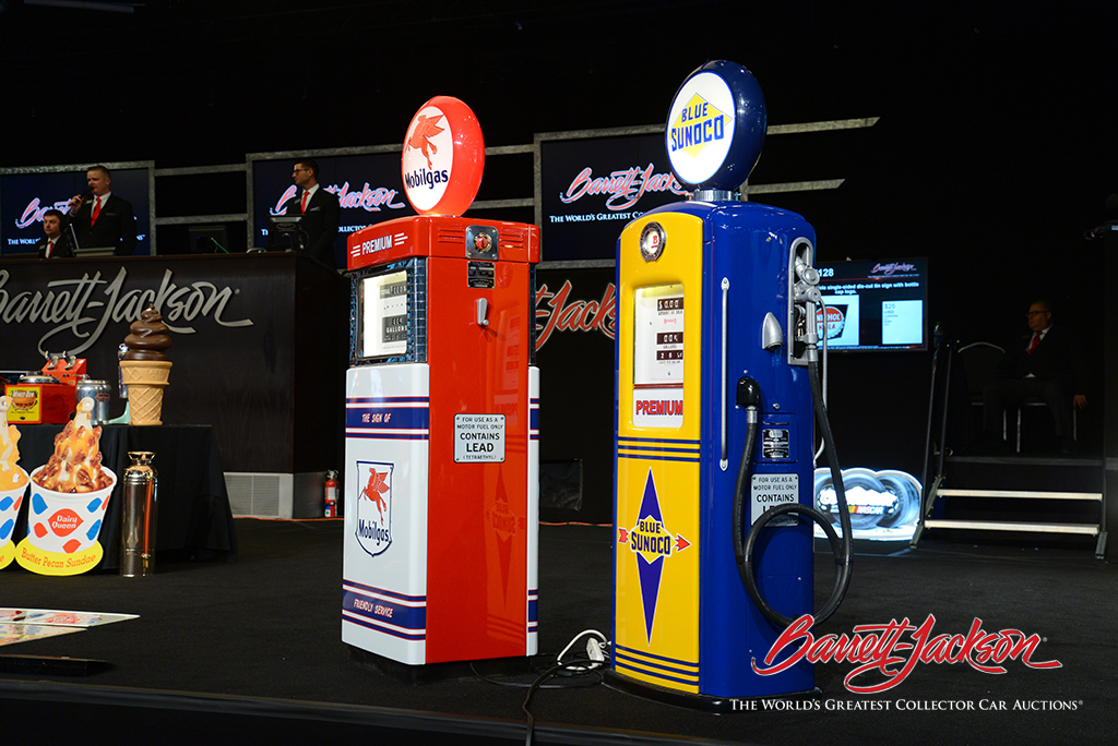 Service station gas pumps took top honors at today's Automobilia Auction, with a Sunoco Oil model from around 1948 (right, Lot #6193) leading the pack.