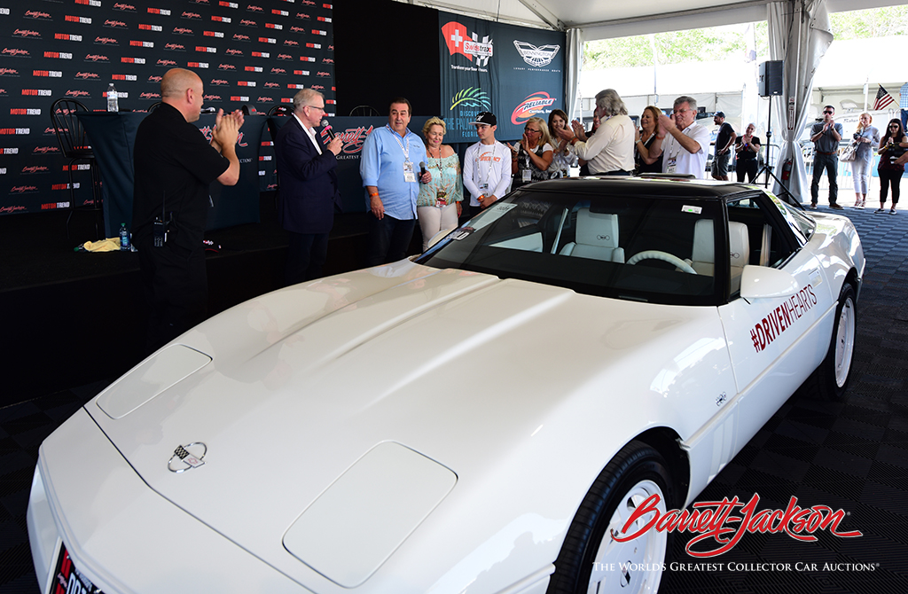 John and Jeanette Staluppi (center), winning bidders on Lot #3001, the Driven Hearts Corvette, donated the car back to be sold again at a future auction to bring more funds to the American Heart Association.