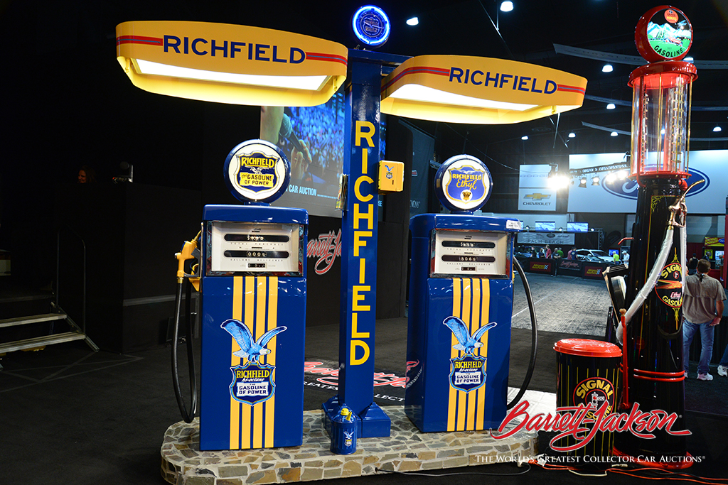 Lot #6385.2, a Richfield gas station island beautifully restored by McLaren Classic Restorations, was today's top-selling piece of automobilia, bringing in $36,800. Next to it is a hard-to-find 1920s visible gas pump restored in Signal Gasoline regalia (Lot #6385), which was another of the day's top sellers.