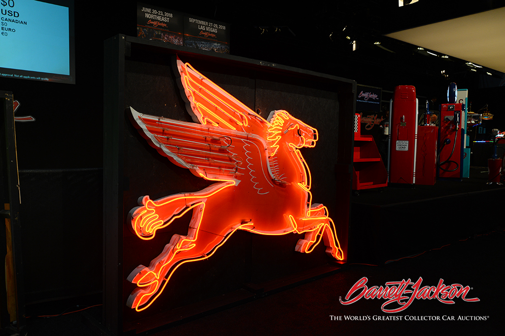 Brightly lit neon signs light up the auction arena every day. This extraordinary Mobil Pegasus example from the 1950s (Lot #6498) went home with a lucky bidder this morning.