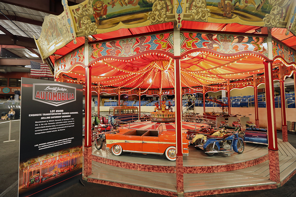 This exquisite transportation-themed carousel sold for $557,750 at the 2018 Scottsdale Automobilia Auction.