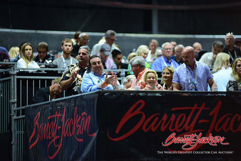 John and Jeanette Staluppi watch from the skybox as their vehicles cross the auction block.