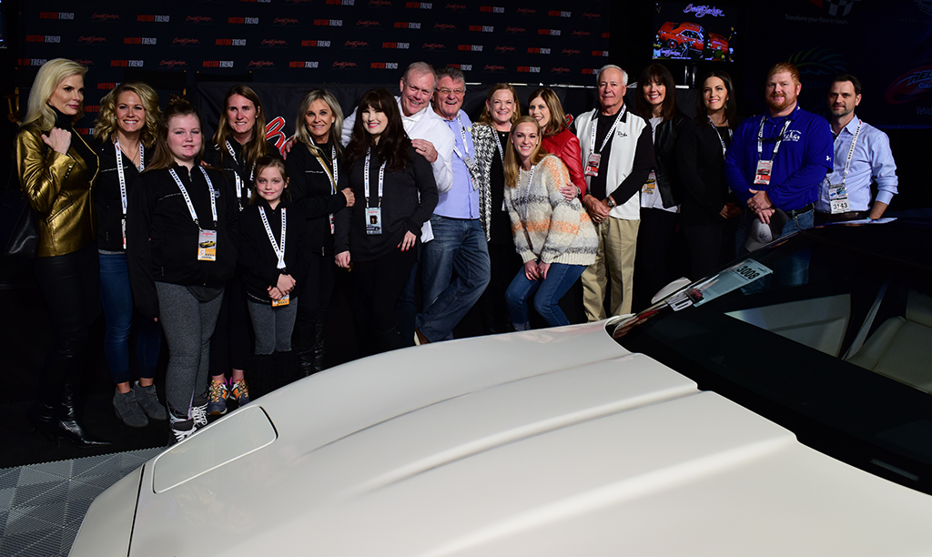 From left: Carolyn Jackson, members of the late Dave Ressler's family, Shelby Jackson, Craig Jackson, winning bidders Joe Riley and Michelle Mauzy, American Heart Association CEO Nancy Brown and other members of the AHA team, after the auction of the 1988 35th Anniversary Corvette to benefit the AHA.