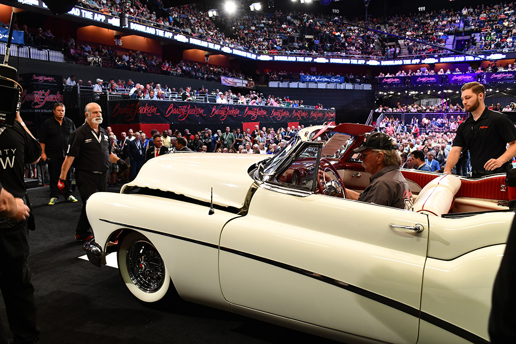 Impressive view from the auction block behind the wheel of a collector car.