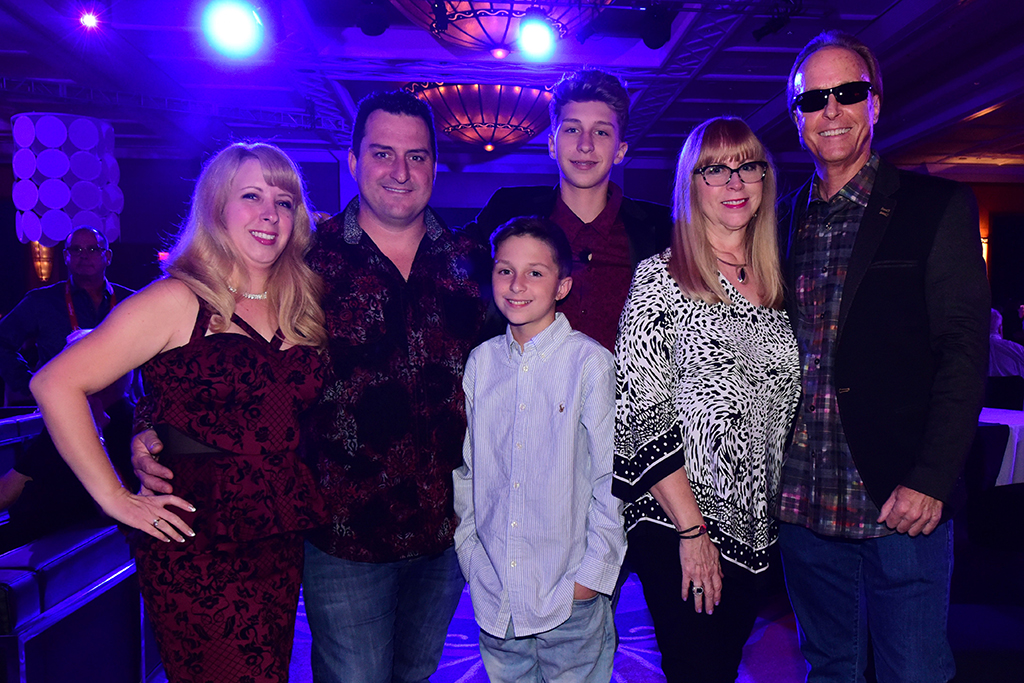 Barrett-Jackson President Steve Davis (right) with his family (from left): daughter Misty and son-in-law Dean McLaren, grandsons Blake and Connor, and wife Janie.