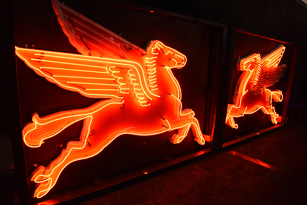 Two iconic Mobil Oil Pegasus animated neons signs were among the top sellers in the Automobilia Auction.