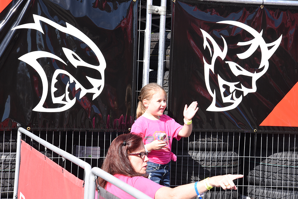 A little angel between a Hellcat and a Demon? Waiting for family at the Dodge Thrill Rides.