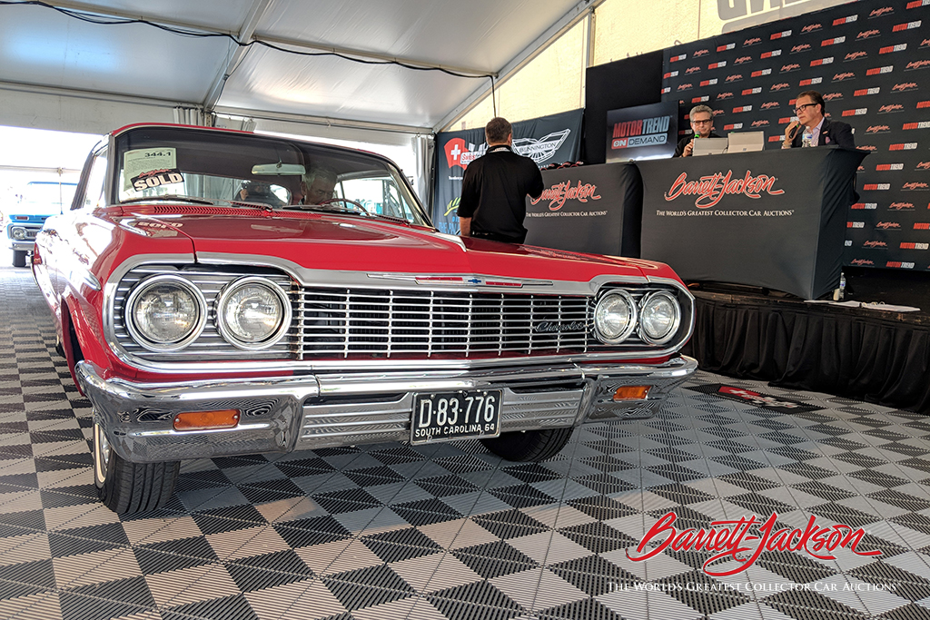 A 1964 Chevrolet Impala (Lot #344.1) made its way to the live stage after its sale.