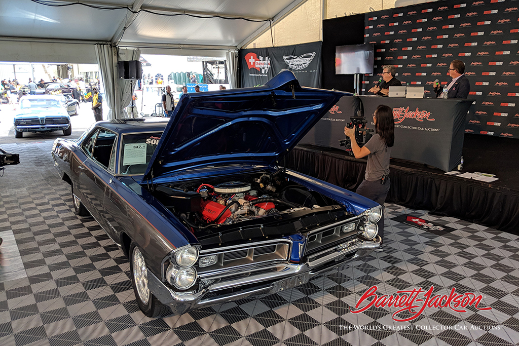 A discussion of the engine of a 1965 Pontiac Grand Prix Custom Coupe (Lot #347.1).