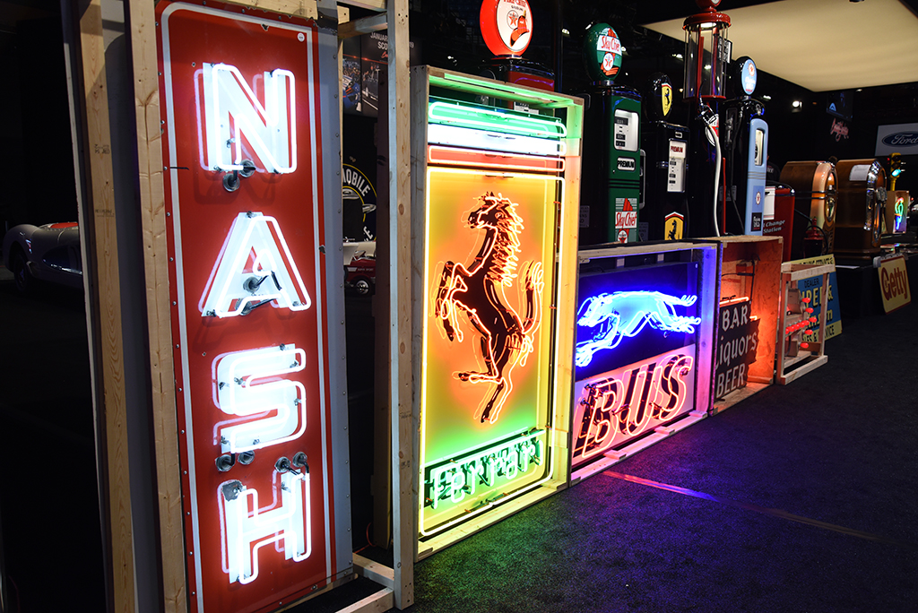 Colorful neon signs adorned the stage during each morning's Automobilia Auction.