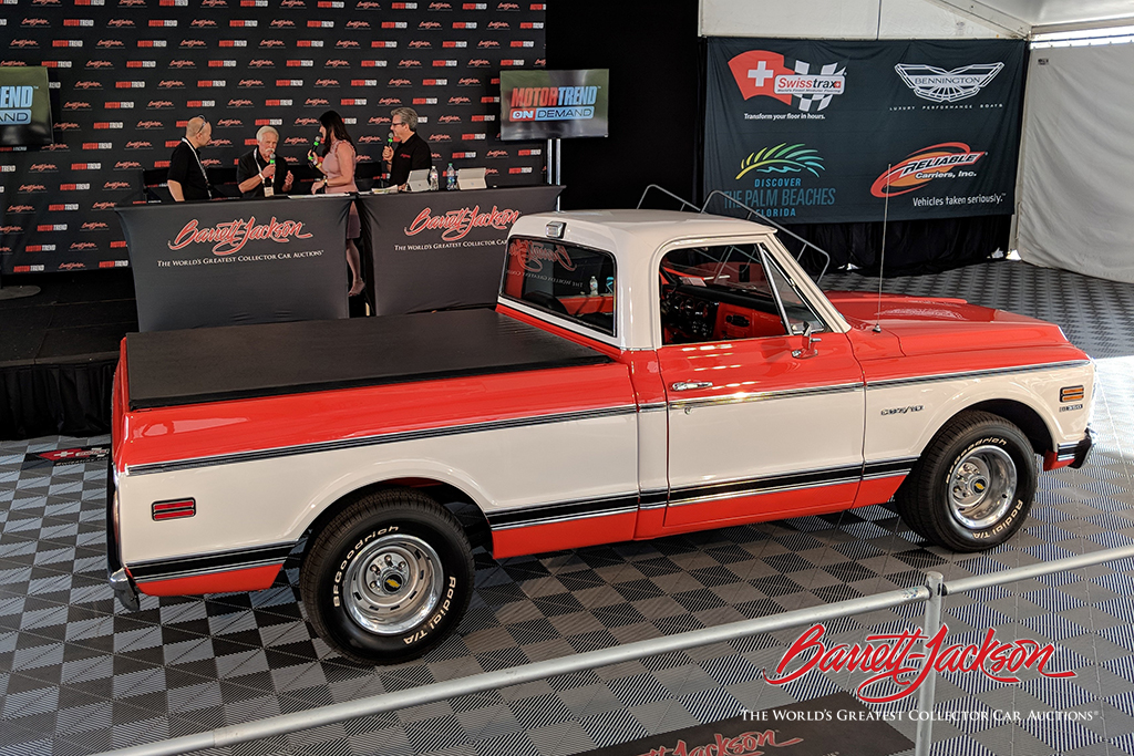 """Wayne Carini of """"Chasing Classic Cars,"""" along with Stanley Black & Decker CMO Mike Simpson and Frann Garrett (American Red Cross, Connecticut & Rhode Island Region), came to the live stage to discuss the charity sale of Lot #3001, a 1970 Chevrolet C10 pickup, to benefit the Red Cross."""